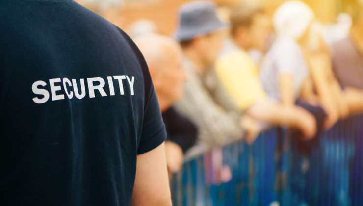 Security officer displaying customer service skills at public event